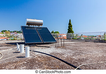 Solar panel, water heater on house roof, green energy