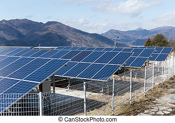 Solar panel with mountain range background