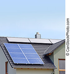 solar panels - A Photograph of a solar panel on the roof