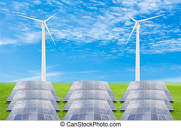 Solar panels and wind turbine on green grass field against blue