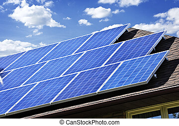 Array of alternative energy photovoltaic solar panels on roof