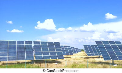solar panels at the field at the hot sunny day with the blue...