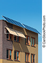 Solar panels attached on the front of a newly build house -...