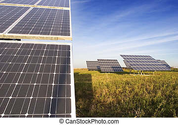 Background: closeup view of solar panels. alternative energy