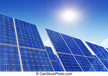 Solar panels, blue sky and sun