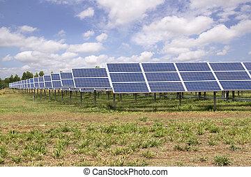 Solar panels farm under blue sky
