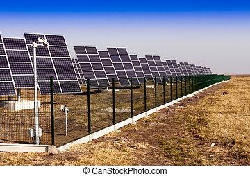 Solar panels installed on the field. - Modern solar power...