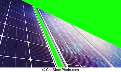 Solar panels during camera panorama. Clouds reflects in panels. You can change background or add graphics to this clip, using greenscreen keying.