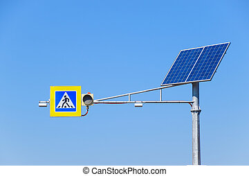 Solar panels on a pole to power a traffic light