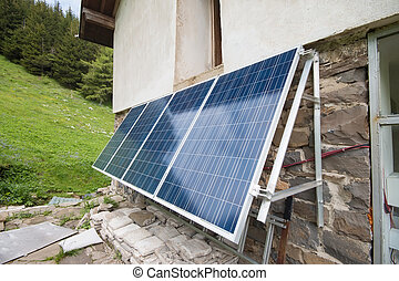 Solar panels on apline hut - Hut high in the mountains with...