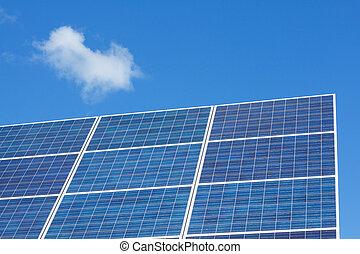 Solar panels on blue sky