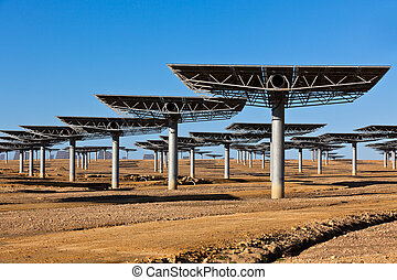 Solar panels on bright blue sky background