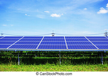 Solar panels on grass with sky.