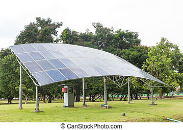 Solar panels on green grass field