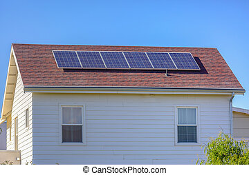 Solar panels on model home in Daybreak