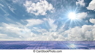 Solar panels on the beautiful cloudy sky, time laps