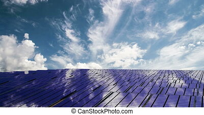 Solar panels on the beautiful cloudy sky, time laps - Solar...