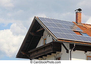 Solar panels on the roof of te small house