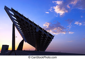 Shining sun and solar panels, Barcelona, Spain