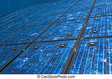 solar panels - Solar panels on a building against blue sky.