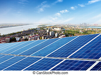 Solar panels - Aerial view of the city and the tower on top...