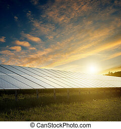 solar panels under sky on sunset - solar panels under blue ...