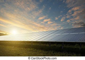 solar panels under sky on sunset