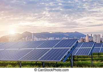 Solar panels with city on background