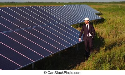 Solar panels with photovoltaic elements installed in the field.