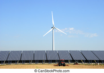 Solar plant with wind turbine at a farm in the...