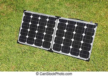 Solar Power Panels - Portable solar panels on green grass....
