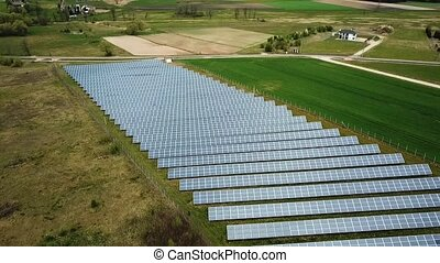 Solar power plant, aerial view - Solar panels from above. ...