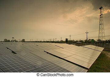 solar power plant  reflected sunlight from sunset.