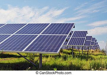 Solar power plant - solar power plant in sunlight on field