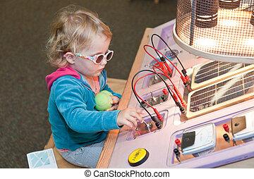 Solar power - Cute little European toddler girl learning...