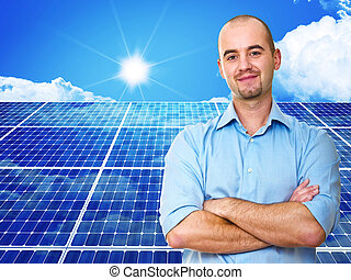 solar power - confident man and power solar station