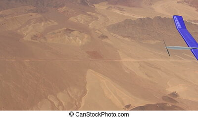 solar powered drone flying over the desert