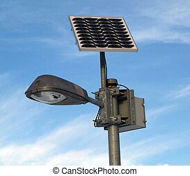 lamp post with Solar photovoltaic powered Light and blue sky