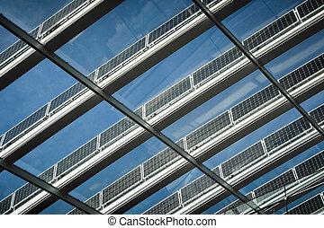 Solar roof panels - Ranks of solar panels soaking up sun...
