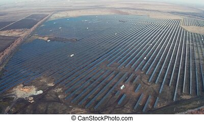 Solar station with many panels of solar cells, aerial view