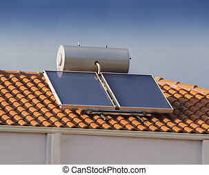 Solar water heater on roof of tile roofed house