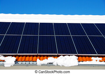 Solarcell - solarcells on a winter roof with snow