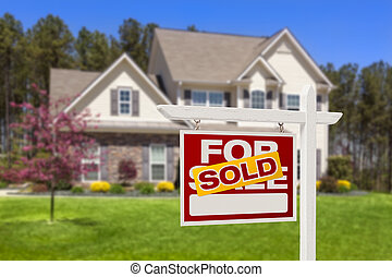 Sold Home For Sale Real Estate Sign and House