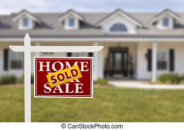 Sold Home For Sale Sign in Front of Beautiful New House.