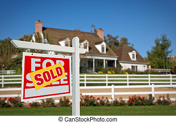 Sold Real Estate Sign and House