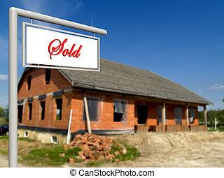 Sold, real estate sign.