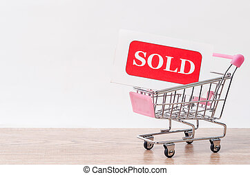 sold tag in shopping cart.