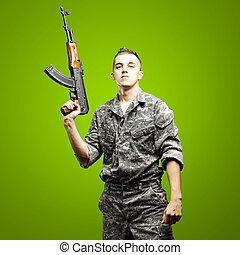 soldado, apontar, jovem