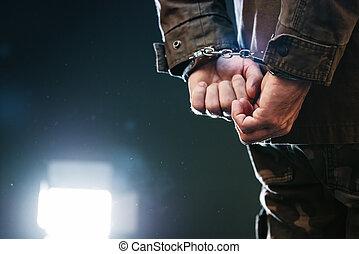 soldat, handcuffed