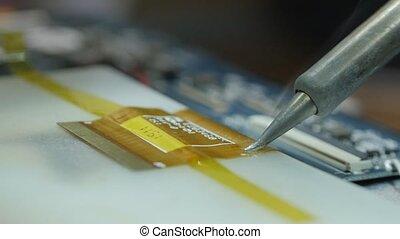 solder a chip. to solder a microcircuit. Soldering a broken...